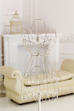 dress form: White vintage metal hanger with wire dress form