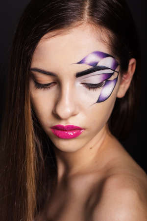 fantasy makeup: Fashion photo of beautiful young woman with fantasy makeup Stock Photo