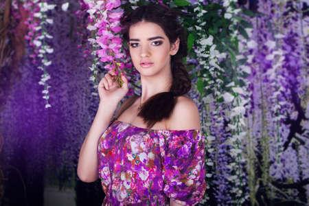 wistaria: Pretty girl with fashion hairstyle in wistaria purple garden Stock Photo
