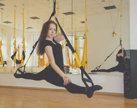 twine: Girl doing twine on trx fitness straps