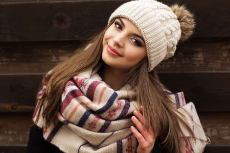 Pretty girl is wearing warm winter clothes Standard-Bild