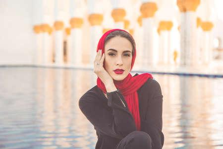 Fashion woman in grand mosque in Abu Dhabi Stock Photo