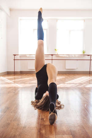 Girl doing stretching exercise for legs
