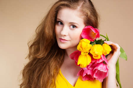 Beautiful redheaded girl with tulips photo