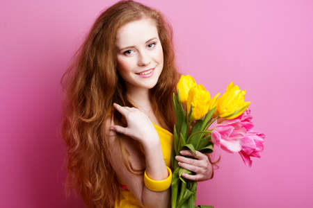 womens: Beautiful redheaded girl with tulips