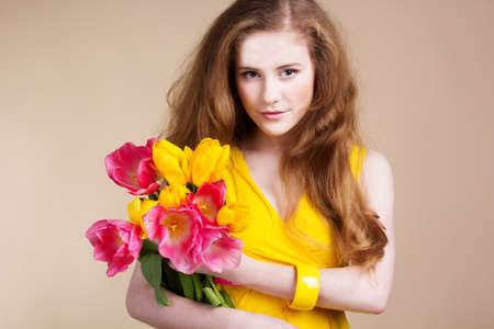 Beautiful redheared girl with tulips photo