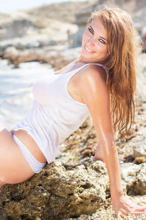 hot lady: Sexy young woman on the sea coast