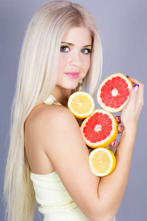 Beautiful blonde girl with fruits photo