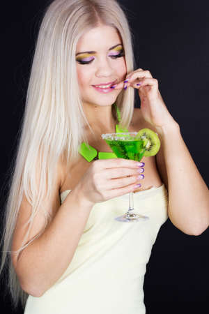 Sexy blonde girl with green cocktail photo