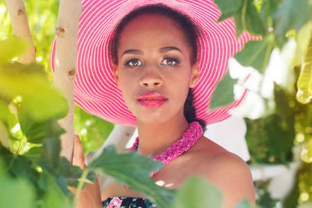 pink hat: Young south african zulu woman is wearing pink hat in outdoors Stock Photo
