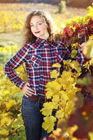 grape field: Grape goddess. Beautiful young lady in colorful grape field