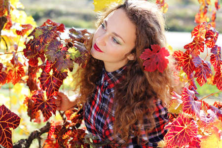 grape field: Portrait of beautiful young lady in colorful grape field Stock Photo