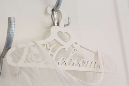 bride dress: Bride white wedding dress with wooden hanger