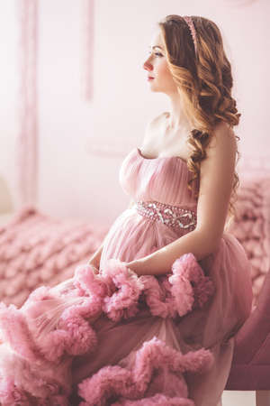 Pregnant woman is wearing fashion dress