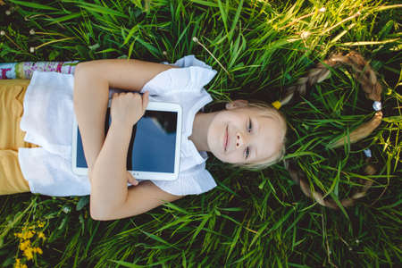 technoligy: Little blonde girl with digital tablet