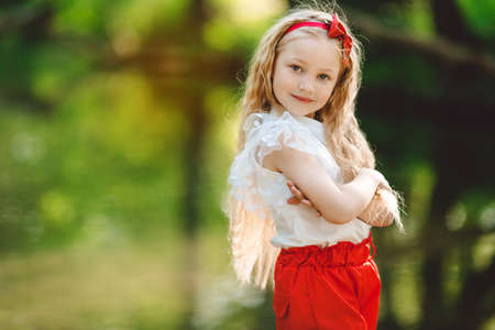 Beautiful little girl outdoors near river Stock Photo