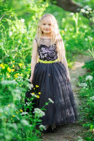 Beautiful child girl in yellow garden