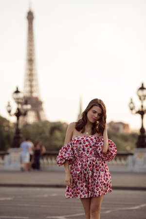 Beautiful girl is walking in Paris with Eiffel tower view , France