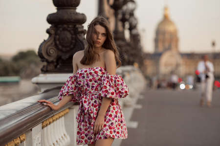 Beautiful girl is walking in Paris, France, summer time Фото со стока