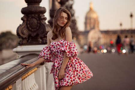 Beautiful girl is walking near the Eiffel tower in Paris, France