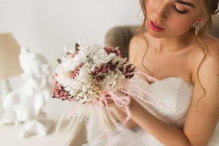 Wedding bouquet in hands of beautiful bride. Wedding concept.