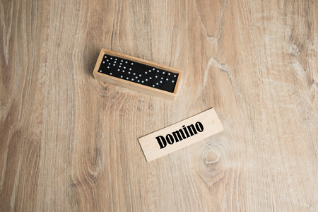 Domino game on a wooden background.