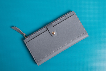 Womens leather wallet studio image. Gray womens wallet. Stock Photo