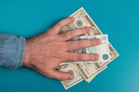 Dollar bills studio image. Male hand holds dollar bills. Money in the male hand. Stock Photo