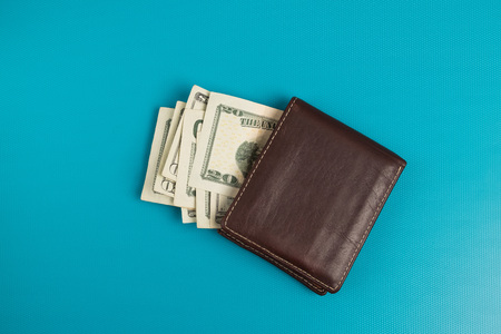 Male wallet with banknotes studio image. Leather wallet with dollar bills. Stock Photo