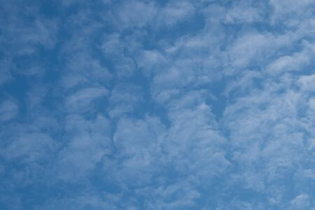 Sky with clouds. Background of blue sky with clouds. Fluffy clouds on a blue sky.