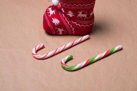 Christmas card. Christmas sock and caramel candies. Candy cane. Stok Fotoğraf