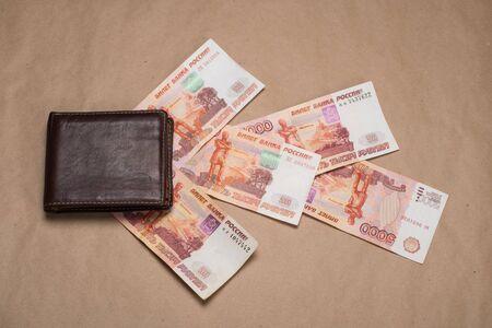 Wallet with Russian money. Studio image. Mens wallet with Russian rubles. Brown wallet with money. 写真素材