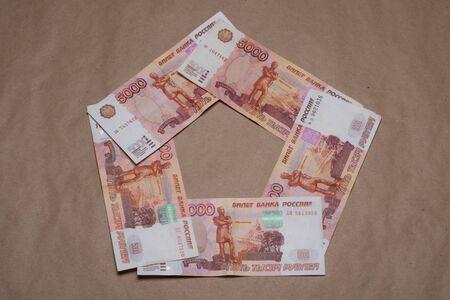 Russian money studio image. Russian rubles. Russian money bills on a beige background.