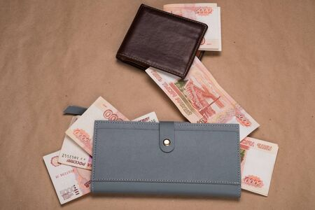 Male and female wallet with money. Wallet with Russian rubles.