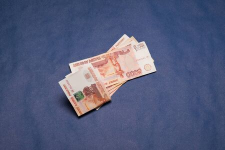 Russian money studio image. Russian rubles. Russian money bills on blue background.