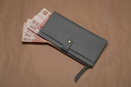 Russian money in a wallet studio image. Womens wallet with Russian rubles. Russian money bills in a gray wallet.