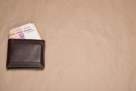 Wallet with Russian money. Empty space for text. Mens wallet with Russian rubles. Brown wallet with money. 写真素材