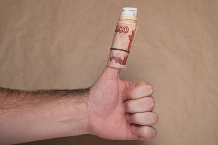 Male hand with russian money studio image. Mans hand holds Russian rubles. Male hand with money.
