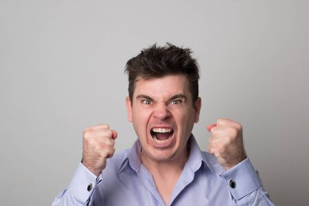 Angry young man. Screaming business man.