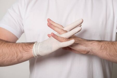 Doctor in surgical gloves. Surgeon before the operation. Male hand in latex glove.