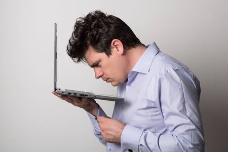 Man with a laptop. Young man works on the laptop remotely.