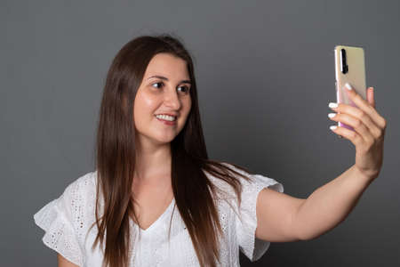 Young woman is talking on a cell phone.