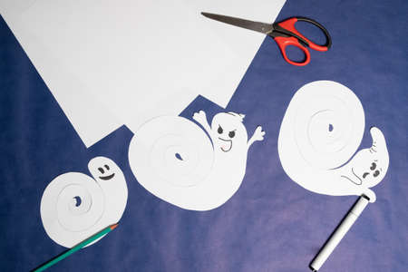 Step 10. DIY Halloween paper ghost. Halloween craft step by step instructions.