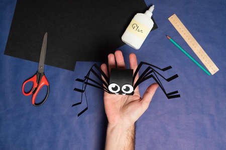 DIY Halloween paper spider. Halloween craft step by step instructions. Step 14.