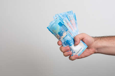Man holds Russian money. Financial theme. Money in men's hands.
