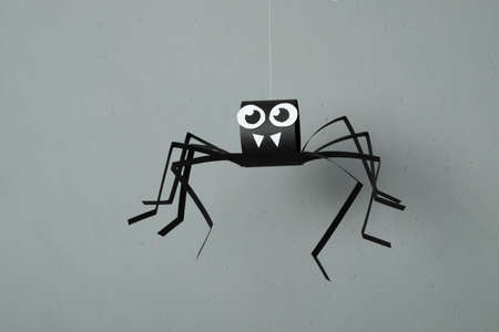 DIY Halloween paper spider. Halloween craft step by step instructions. Step 16.