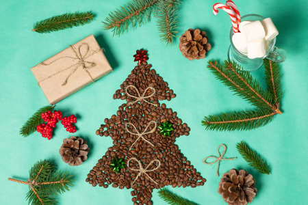 Christmas composition with food and drink. Christmas tree made from coffee beans. Flat lay, top view.