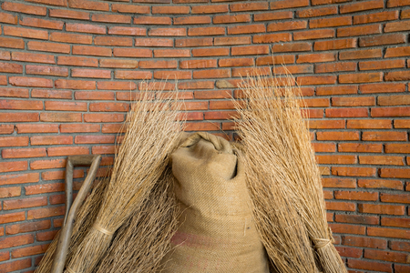 brick wall with hemp sack of seed and dried rice Stok Fotoğraf
