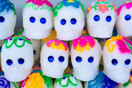 The colorful skulls will be taken to the altars of the dead. Archivio Fotografico