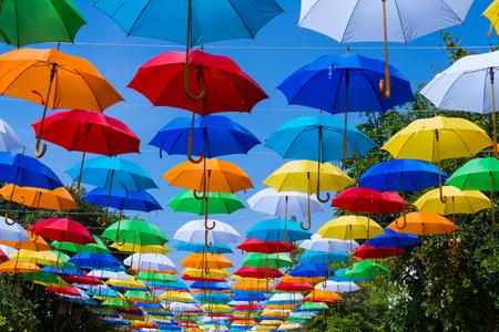 Umbrellas decorate the street.